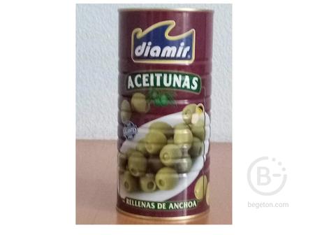 Diamir aceitunas rellenas de anchoa.Фаршированные оливки.