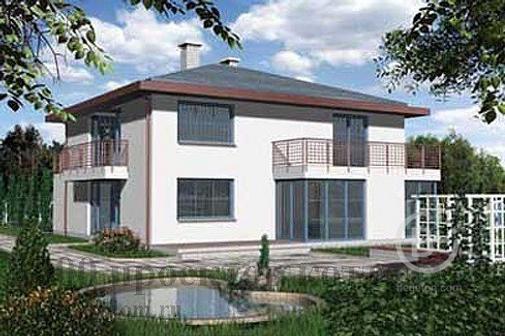 Двухэтажный кирпичный дом в средиземноморском стиле.