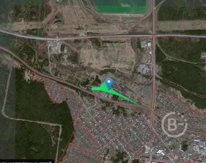 Промышленная площадка с ангаром и железнодорожными путями в г. Ревда